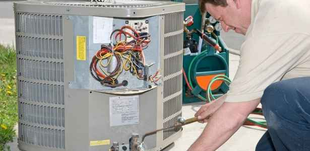 AC unit with a tech working on it