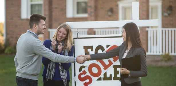Couple and agent after house sold.