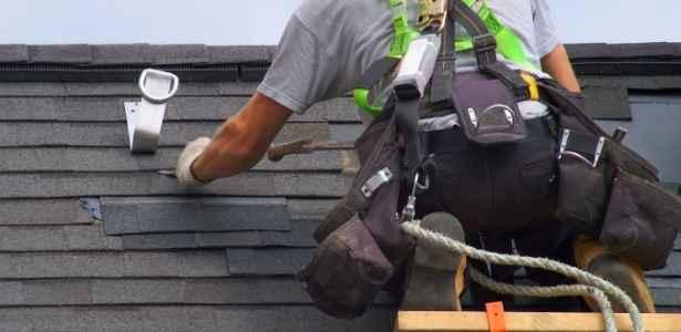 Man making a roof repair