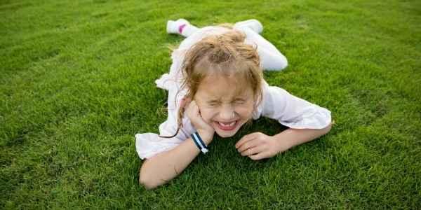 A little girl on the grass