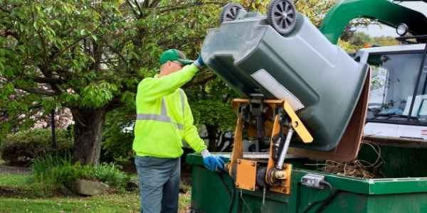 Waste management company emptying the trash