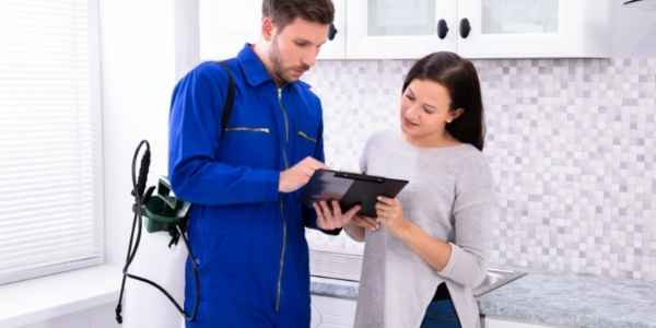 pest control specialist explaining services rendered