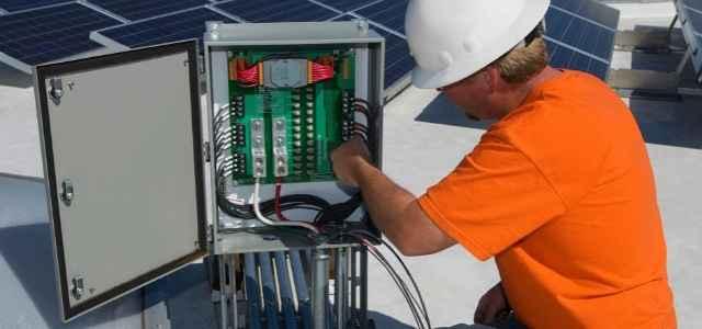 Man installing solar panels on the house