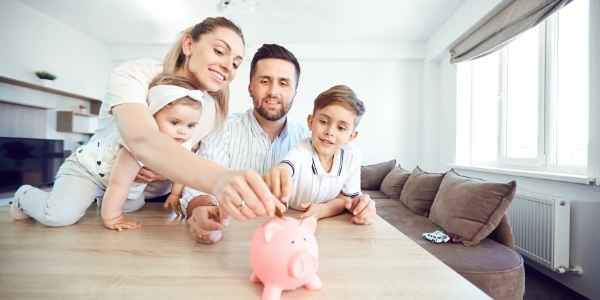 Parents teaching a child to save money