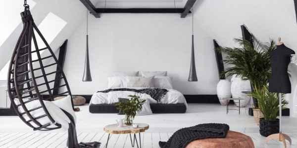 Attic bedroom in black and white