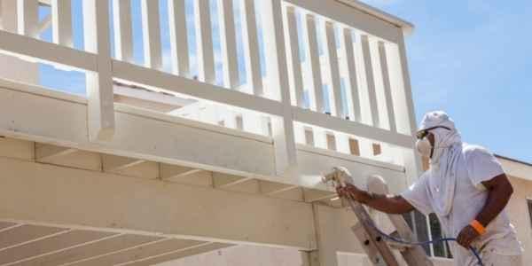 Man spraying a house