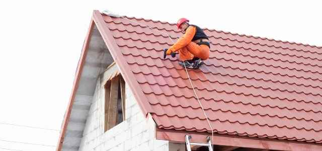 Roofer fixing a roof
