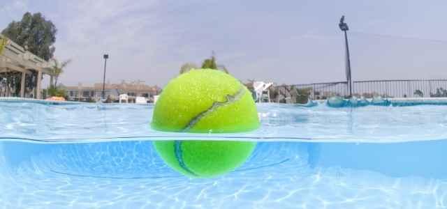 tennis ball in swimming pool