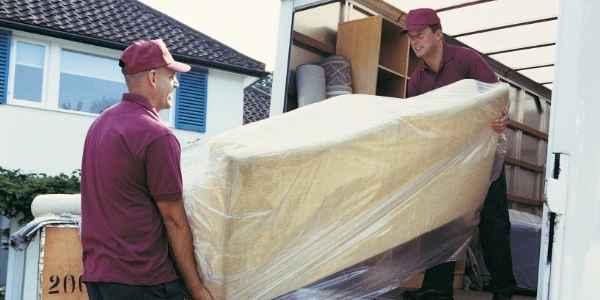 Moving company loading a van
