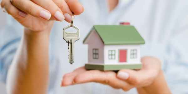 Secured home in hand and key in other